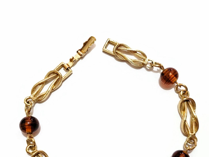 Avon Bracelet Gold Knot Bracelet Faux Tortoise Shell Amber Brown Translucent Beads Fold Over Clasp Chain Link Style Love Knots 7.5 Long
