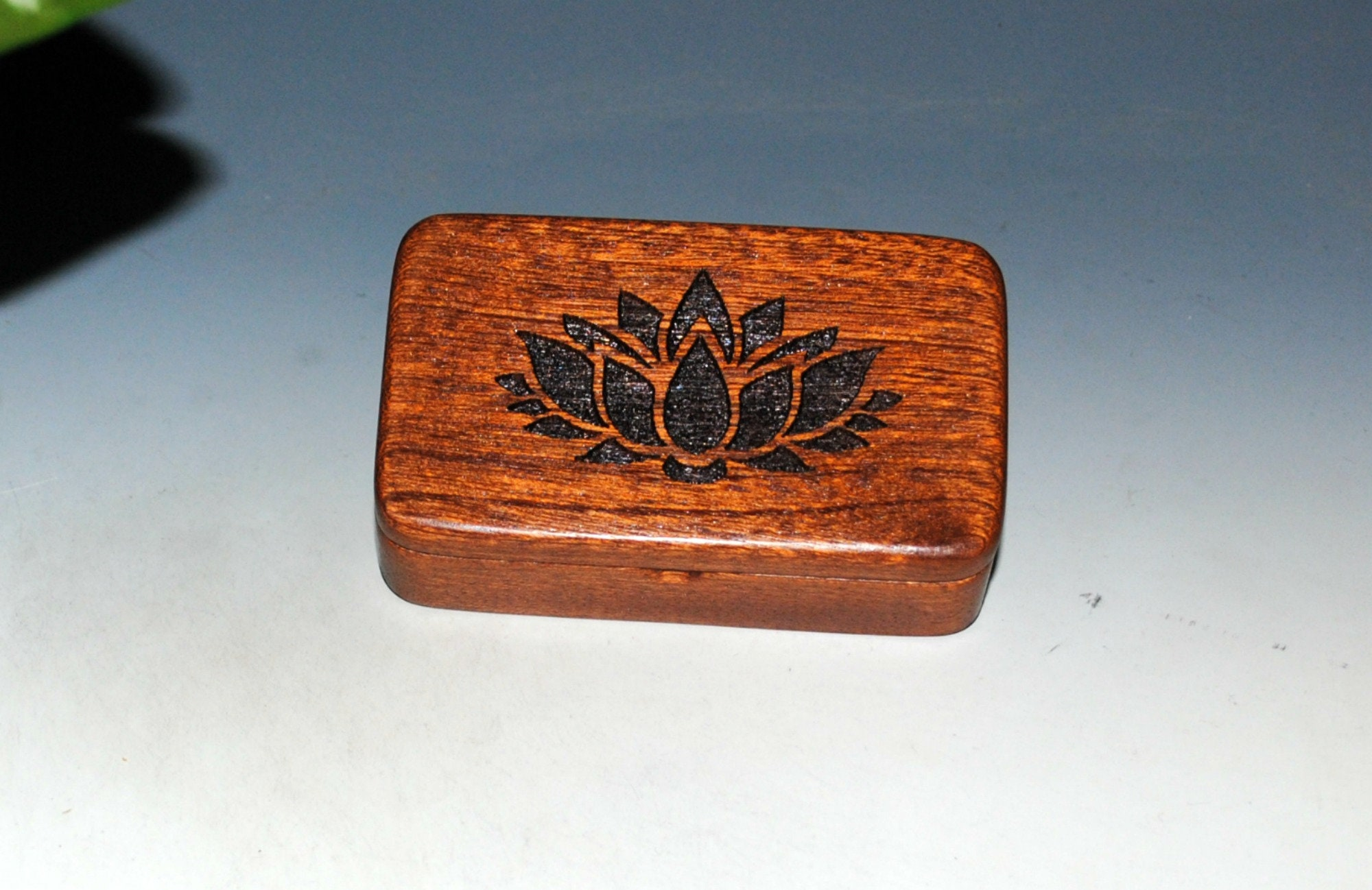 Small Wooden Box With an Engraved Lotus on Mahogany