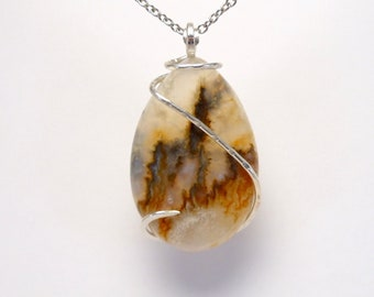 PLUME Agate held in Cold Forged Silver Curl Setting