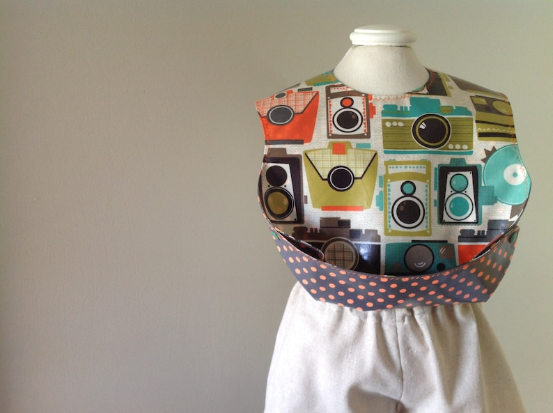 1bea7fa7eaf76 Boy Pocket Bib, Retro Cameras in laminated cotton, perfect for your little  shutterbug, wipeable, washable BPA Free, adjustable snaps at neck