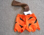 Bam Bam Costume option of club size 0-3 months through size 6 includes shorts, bone and strap option of club