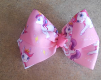 Pretty ponies hairbow grosgrain approx. 4 inch hairbow attached to lined alligator clip with or without crochet headband