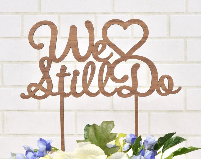 "We Still Do - Anniversary Cake Topper with Heart. Laser Cut Wood. Choose from Draftboard, Gold, Rose Gold, Silver, Maple, or Walnut. 6"" wide"