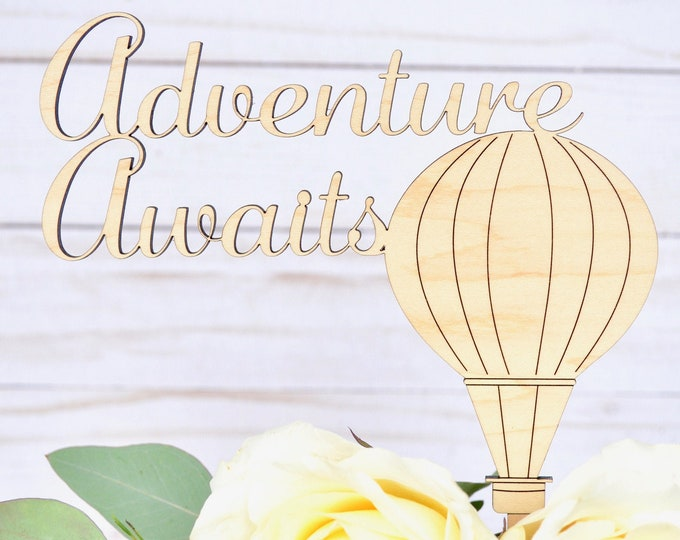 "Adventure Awaits Hot Air Balloon Cake Topper. Custom Colors: Gold, Rose Gold, Silver, Maple, or Walnut.  6.5"" wide x 7.75"" tall."
