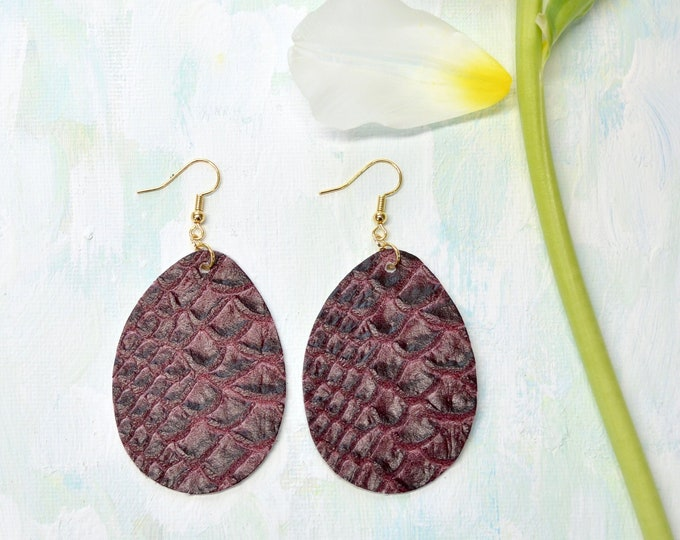 Textured Burgundy Leather Teardrop Earrings. Choose from two sizes and either gold or silver finish nickel free hardware. Genuine Leather.