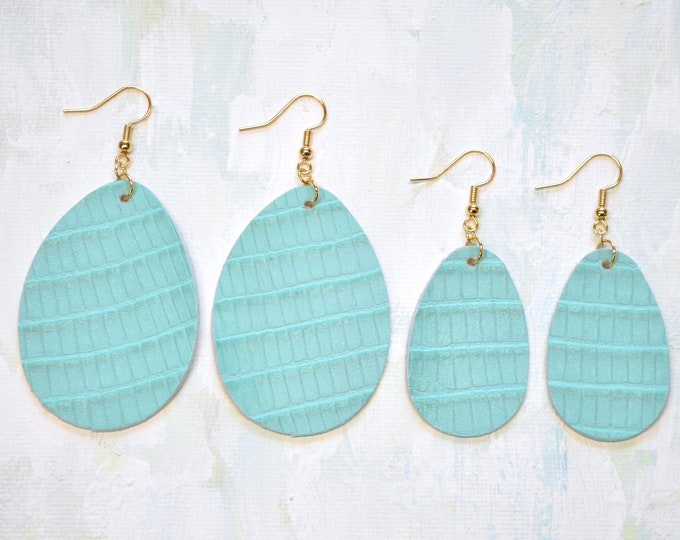 Textured Tiffany Leather Teardrop Earrings. Choose from two sizes and either gold or silver finish nickel free hardware. Genuine Leather.