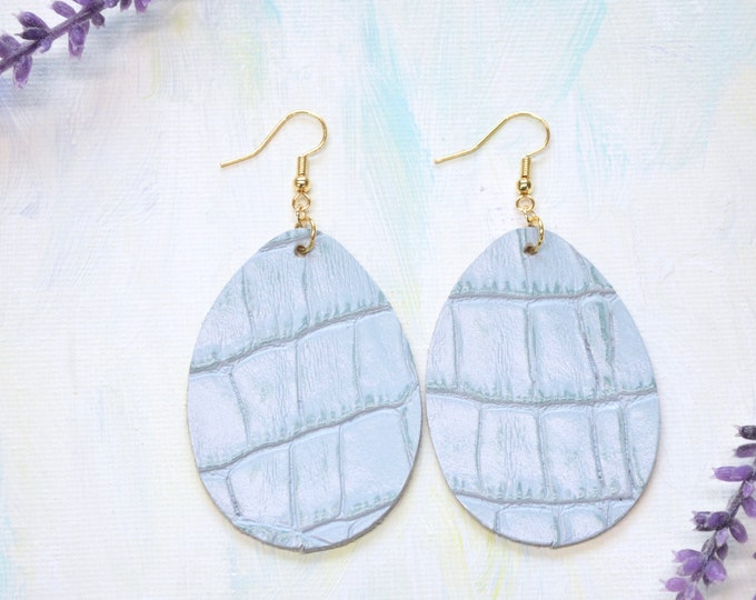 Light Turquoise Textured Teardrop Earrings. Choose from two sizes and either gold or silver finish nickel free hardware. Genuine Leather.