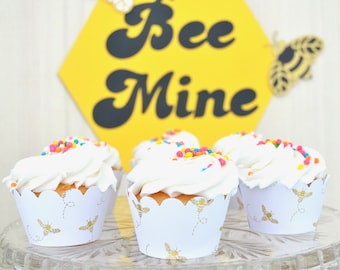 Gold Honey Bee Cupcake Wrappers and Honey Comb Shaped Toppers - Gold foil bees on white card stock. Perfect for Bee-thdays, weddings & more!