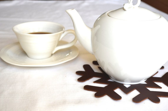 Leather Snowflake Trivet, a thick leather trivet perfect for hostess gifts!
