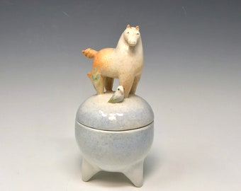 Horse and parrot container by Margaret Wozniak