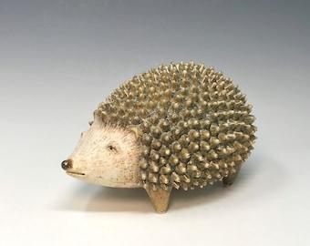Brown hedgehog sculpture by Margaret Wozniak