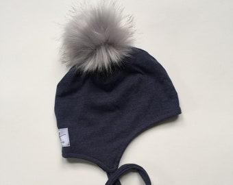 f6ba39aa68e Heathered denim jersey lycra knit pom pom hat