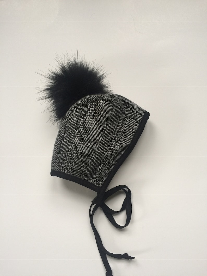 6105a0082 Black herringbone wool pompom bonnet lined with black cotton