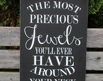 The Most Precious Jewels You Will Ever Have Around Your Neck are the Arms of Your Children Distressed Painted Sign
