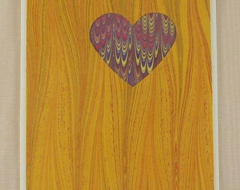 SHC119  Heart Card of Yellows holds up a marbled purple Heart.