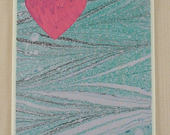 "SHC118  Marbled Pink Heart Card surrounded by a Blue Lagoon splahes up to says ""I Love You!"""
