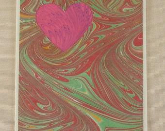 "SHC106  Marbled Pink Heart Card surrounded by a swirls of Red and Green leaps up to say ""I Love You!"""