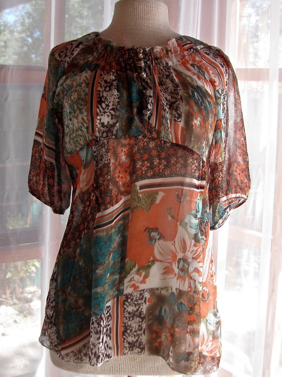 Sheer orange and turquoise blouse with front smock
