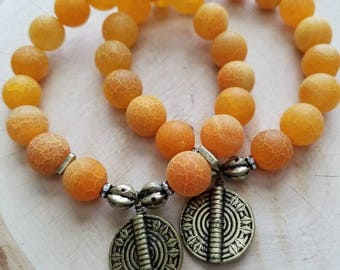 Stretchy bracelet/Sunburst agate/tribal medallion/handmade bracelet