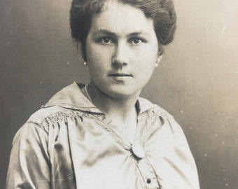 Vintage photograph serious lady sepia tone original photo from Germany