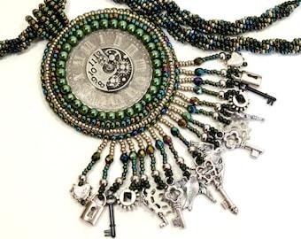 Green and gunmetal Steampunk Necklace Clockwork Beadwoven Gears Locks Keys