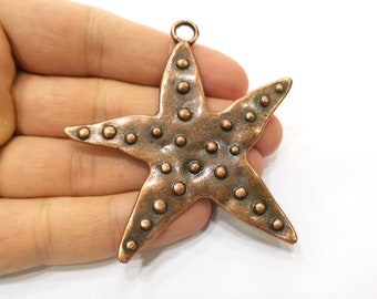 2 Starfish pendants antique copper tone CC5