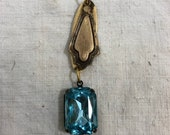 Vintage crystal,blue crystal attached to a beautiful aged bronze in color finding,necklace part,earring parts,