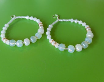 Beautiful beaded earrings with white silverite and cloudy beads. Gold,silver and rose gold accent beads.