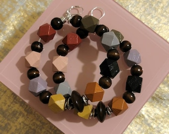 Multi colored beaded wood earrings. Approx 3 1/2 in top to bottom.