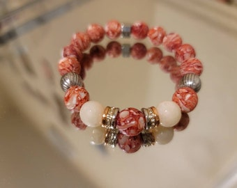 Red and white shell and resin beads with rose gold, silver and gold (bling)  spacers Approx 7 1/2 in