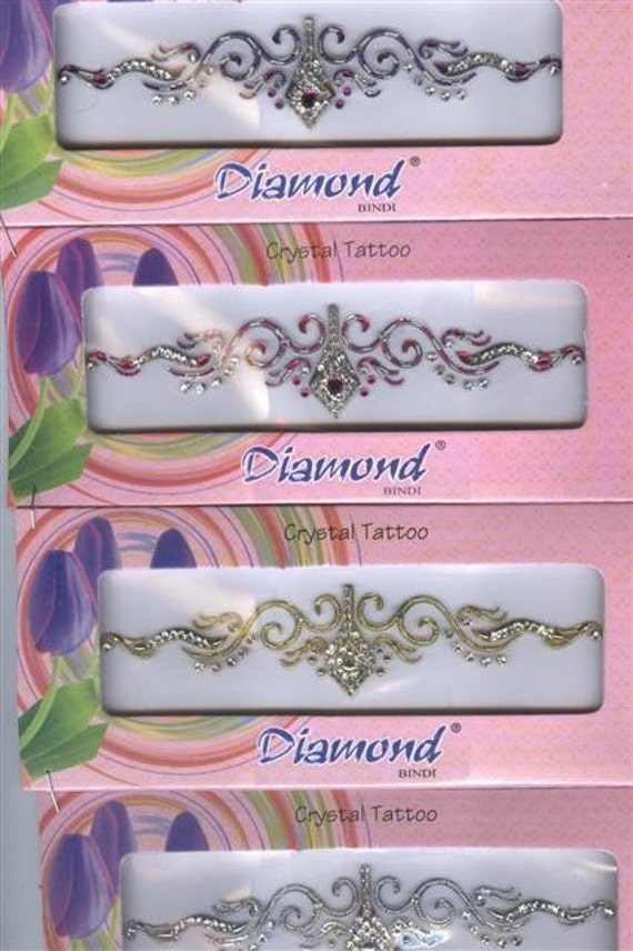 Brilliant Swarovski stones adorn this priceless body decor face low back cleavage arm by Definitions