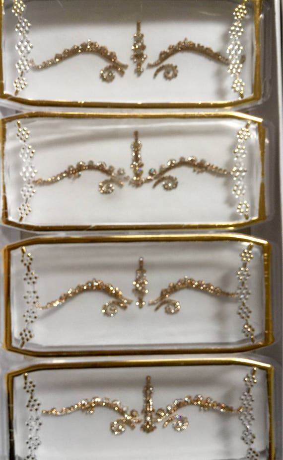 Hand cut and encrusted with swarovski stones, pretty Bridal head piece or use as body decor tramp stamps Gold And Silver,couture ramp Bridal