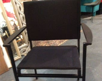 Modern Metal Arm Chair with upholstered back and seat.