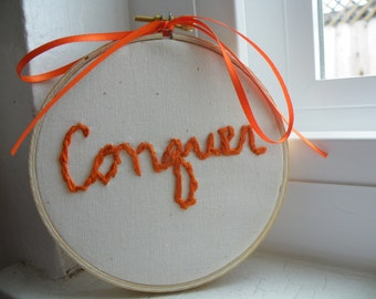50% off this item, enter LOVE99 at checkout, Conquer, Hand Embroidered, Emboridery, Orange, Word Embroidery