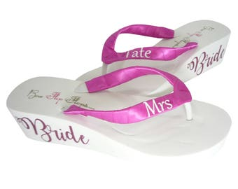 956540dd829bf Garden Rose Hot Pink Mrs Last Name Wedge Flip Flops with Script Bride  Lettering Sides