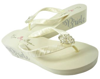 424b78a9d Rhinestone Embellishment Bride Lettering Wedge Flip Flops in Ivory or White  - customizable options