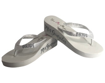 e8c9cab1e690f1 Silver   White or Ivory Personalized Wedding Flip Flops for the Bride with  Glitter Lettering and Satin Ribbon