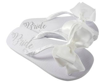 9746cc5b418 Satin Bow Bride Flip Flops with Shimmer Lettering on the sole of white flat flip  flops