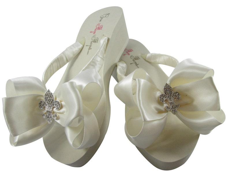 df2952584f5ff3 Bridal Flip Flops Fleur de Lis Rhinestone Satin Ivory Bows