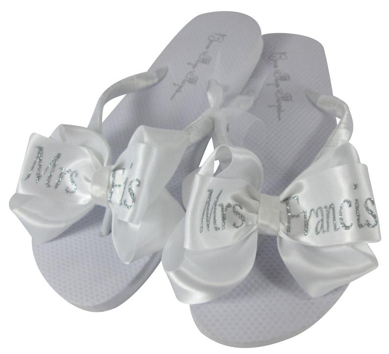9388b0df999 White   Silver Glitter Bridal Flip Flops-Wedding Wedge or