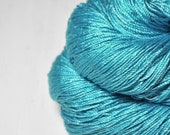 Blue morpho taking a dirt nap  - Cordonnette Silk Fingering Yarn - Turquoise Hand Dyed Yarn - handgefärbte Seide - DyeForYarn