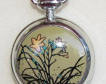 Floral Pendant Watch on a Beige, Blue and Black Kumihimo Cord