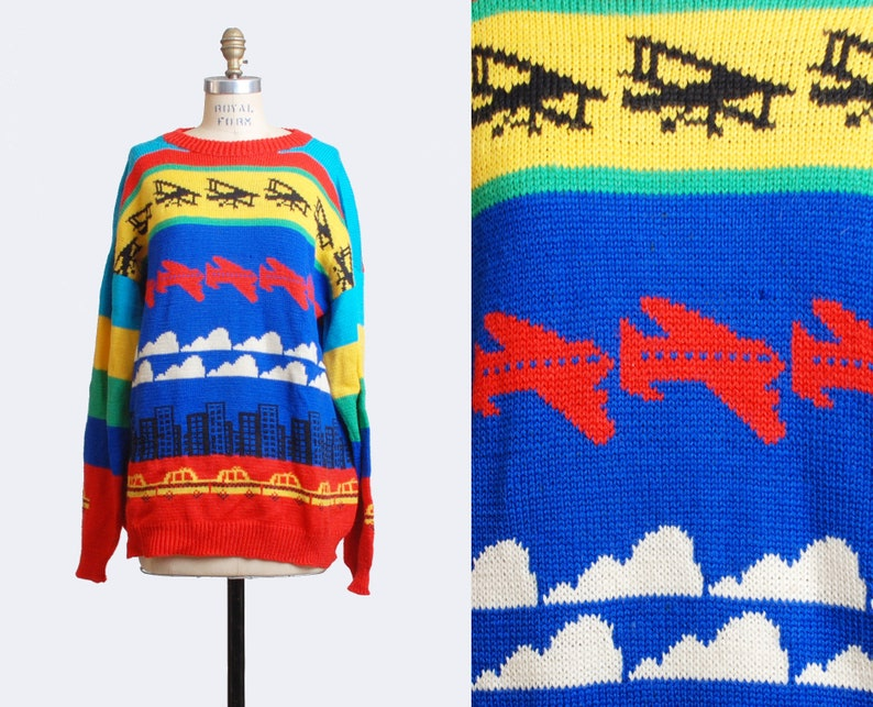 2dc2b8f1a39beb Vintage 80s Plane Graphic Hipster Color Block Sweater   1980s