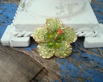 Green glass flower brooch