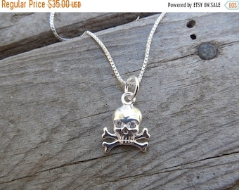 ON SALE Skull and crossbones necklace in sterling silver with cz's set in the eyes