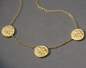 a triplet sand dollar necklace /choker in silver in 18K green gold with diamonds