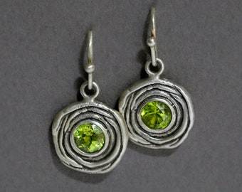 nested oxidized silver earrings with either garnets, peridots, or amethysts