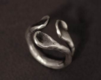"a ""hug"" ring in sterling silver"