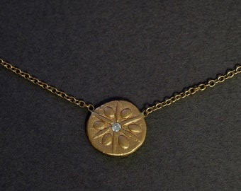 sand dollar choker in 18K rose gold with a diamond