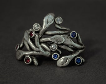 sculpted branch silver ring with rubies or sapphires